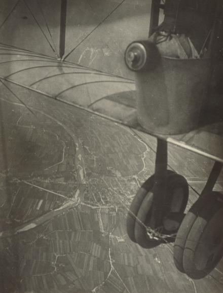 [Aerial shot, cityscape and airplane wheels] Azari